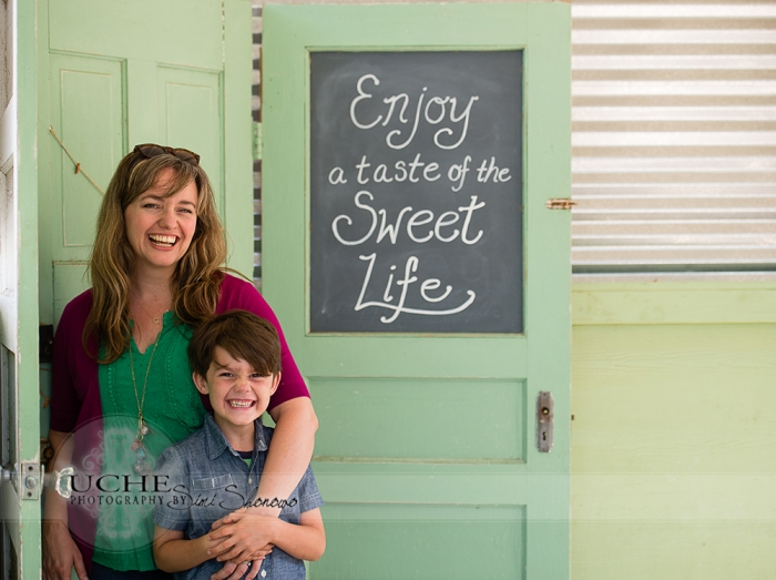 10_finn and tsh giggling after my joke at the enjoy a taste of the sweet life sign outside Sweet Lemon Kitchen Georgetown Texas