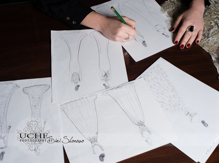 07_new custom wedding dress drawing on Ashley's desk in A.Cherie couture studio with several other dress drawings as it takes shape